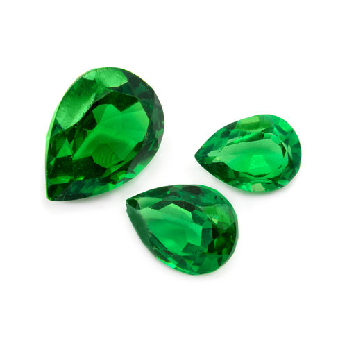 Green Emeralds On A White Background Precious Gems