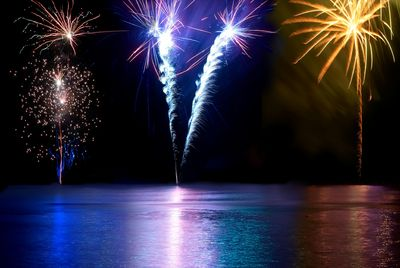 Blue Red White And Yellow Colorful Fireworks Above The River Holiday Celebration