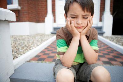Little Boy Sitting On Steps