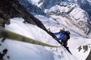Mountain Climber Going Up Snowy Mountain