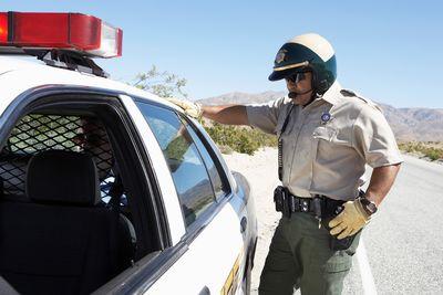 Police Officer Arresting A Man