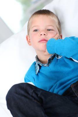 Portrait Of Kid Sitting In Sofa