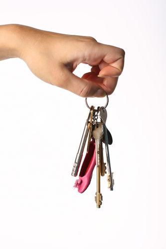 Girl Hand Take Key In Fingers