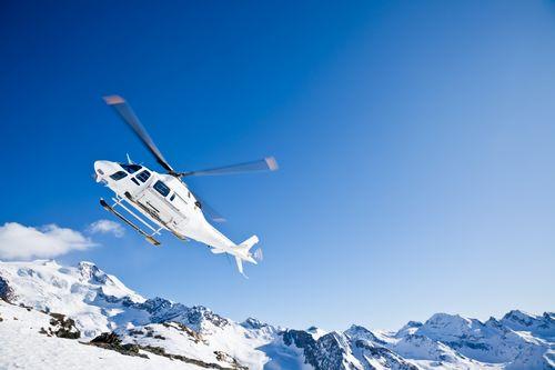 Heli Skiing Helicopter Is Landing On A Ski Slope In Gressoney Ski Resort Aosta Italy