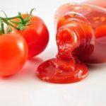 Tomato Ketchup And Fresh Tomatoes Close Up