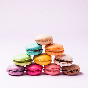 Colorful Macaroons French Dessert Over Pink Polka Dot Napkin