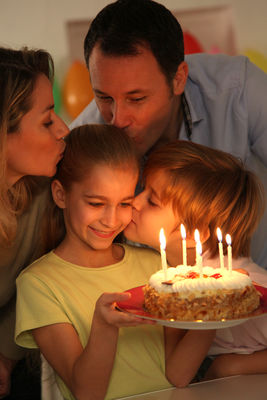 Family Celebrating Child Acutes Birthday