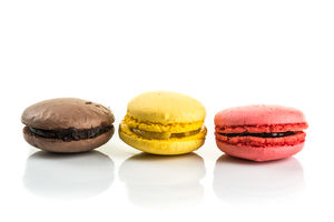 Three Tasty Colorful Macaroons On White Background
